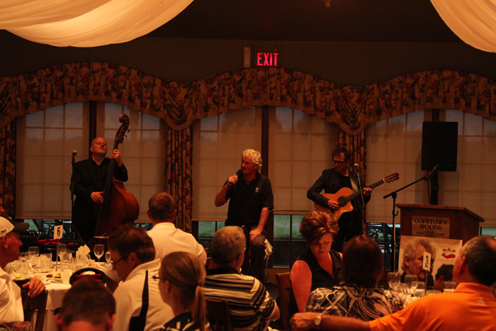 Entertaining the crowd after a fun day golfing,  singer John McDermott had the crowd tapping and clapping  accompanied by bassist George Koller, left, and Jason Fowler.
