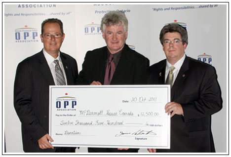 Cheque presentation to McDermott House Canada on behalf of the OPP Association on October 20th, 2011 by President Jim Christie (L) and Director Todd Provost (R). The donation was a combination of the fundraising from the OPP Association 2011 Charity Golf Tournament and a charitable donation from the OPP Association. The OPP Association is the exclusive bargaining agent representing over 9000 uniform and civilian non-commissioned Members of the Ontario Provincial Police.