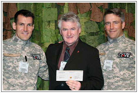 Presentation of a Cheque for $50,000.00 to McDermott House Canada on March 2, 2011, from Shaun Francis, Chair ( L ) and Michael Burns, Founding Member and Board Director (R), from the True Patriot Love Foundation.